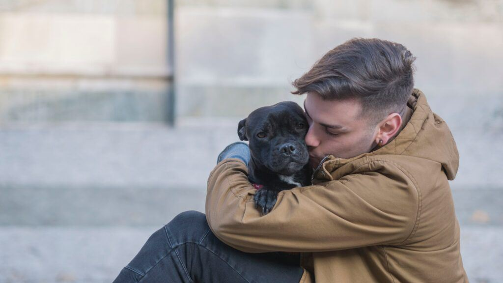 man-hugs-puppy